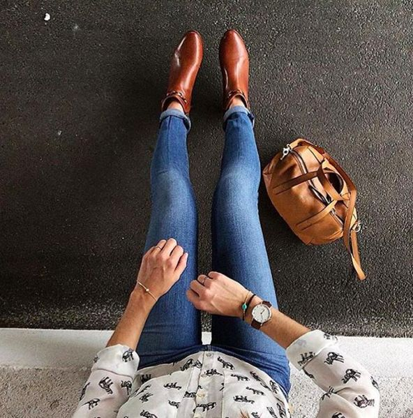 Camel boots and Daniel Wellington watch.