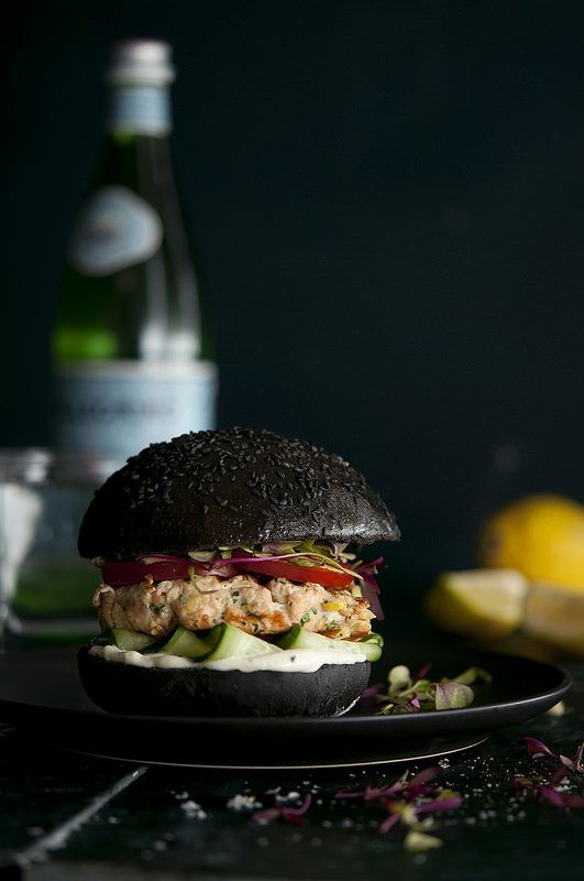 "Squid Ink Sal­mon Burger       When I was in Lis­bon this year I tasted the most amaz­ing thing: a squid ink sal­mon bur­ger. Not only did it look freakin' cool it tasted even bet­ter. The squid ink is subtle, yet com­pletely notice­able and integ­ral. The fla­vour, which I can only describe as being ""the sea' or hav­ing a 'seaness' trans­forms a simple sal­mon bur­ger into a fant­ast­ical delight – there really is some­thing quite fun in eat­ing a black burger.     The squid ink…"