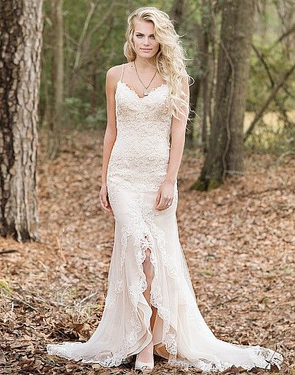 Step out in this unique fit and flare gown featuring spaghetti straps, point d'esprit, lace appliqués, modified V-back, and a tiered split front skirt with finished hem.