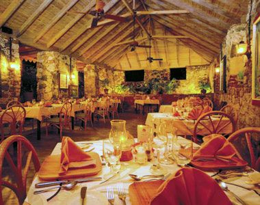 The Sugar Mill restaurant in Tortola, British Virgin Islands`  Listed as one of the most Romantic Restaurants.  Food & Leisure Magazine!  Totally awesome!