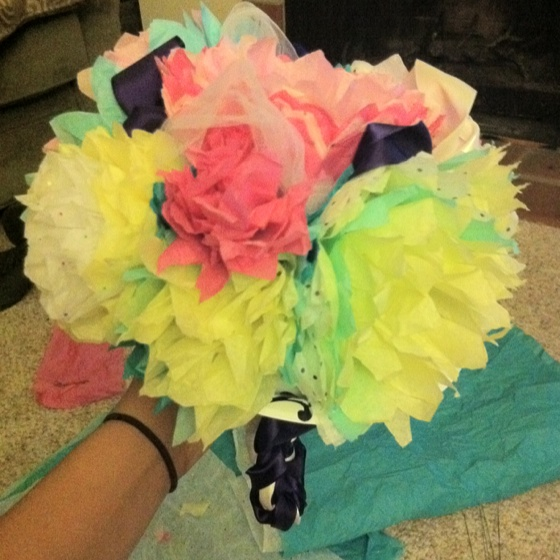 Wedding rehearsal bouquet made out of tissue paper flowers.