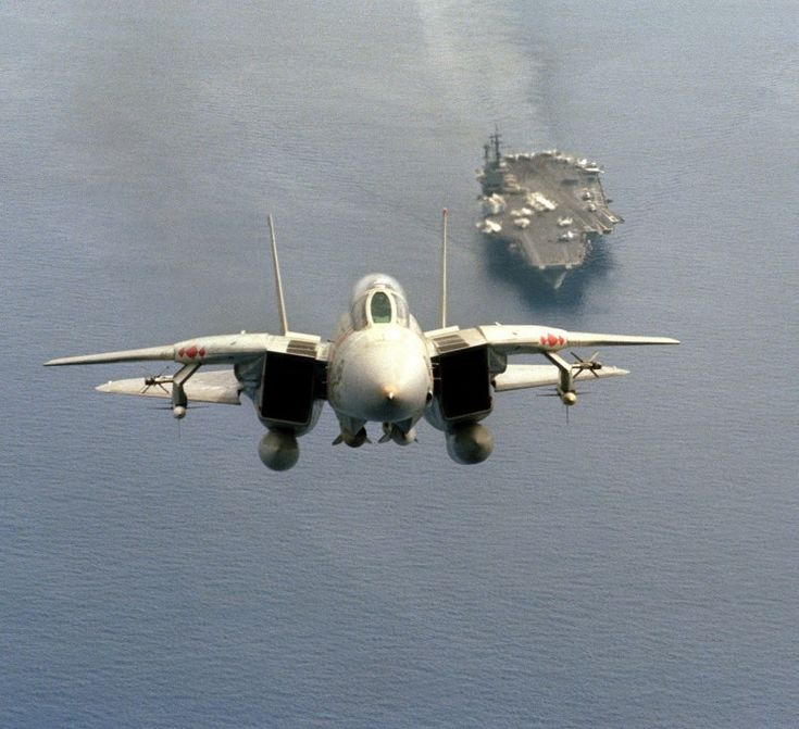 An F-14 launched from the USS America (CV-66) in 1984
