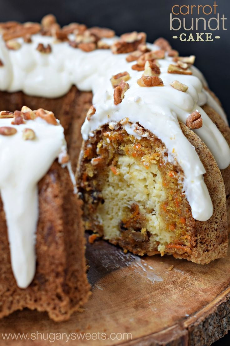 Carrot Bundt Cake with a ribbon of cheesecake swirl, cream cheese frosting, and topped with pecans