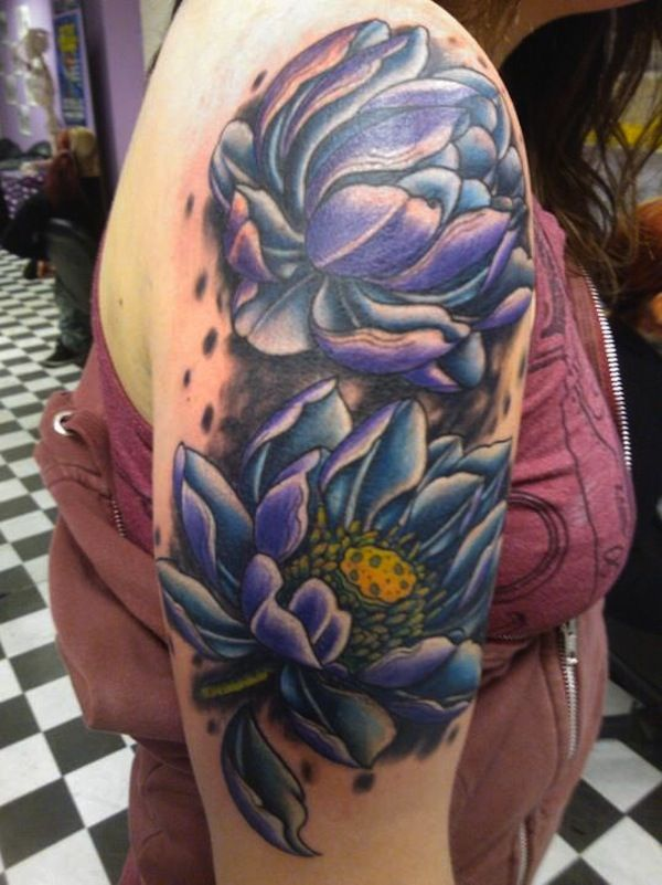 Twin purple lotus flowers. Tattooed on the arm, the purple lotus flowers look regal and eye catching. They are drawn as open flowers thus signifying openness and acceptance of the mystic nature of the spirit.