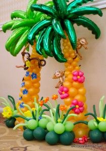 Luau decoration ideas - balloon palm tree, flowers and monkey