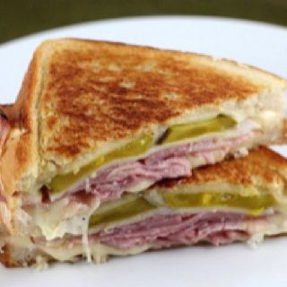 This is by no means an authentic Cuban sandwich but just a simple idea for a Cuban sandwich inspired grilled cheese. This recipe does not use sliced or pulled pork but uses sliced turkey instead. Ham, turkey, Swiss cheese, and dill pickles are piled onto sour dough bread and lightly grilled on both sides in the pan. For the dressing you can use either mayonnaise or mustard or both. I like to pile massive amounts of ham, turkey and Swiss onto my sandwiches, but this actual recipe calls for…