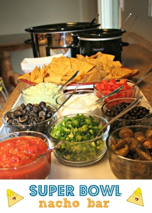 Super Bowl Snacks. Setting up a nacho bar is a great way to feed your friends in a self-serve manner. Just cook the meat and beans beforehand in your Crock-Pot and set up each accompaniment that you wish to include.