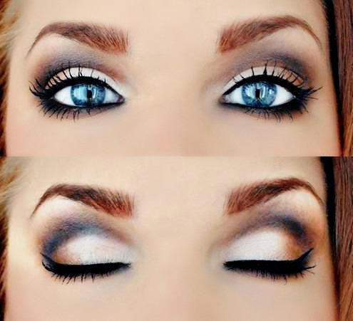 Eye make-up. Black out with a touch of dark brown on the sides and gold/creme for the eye lids. Beautiful. :)