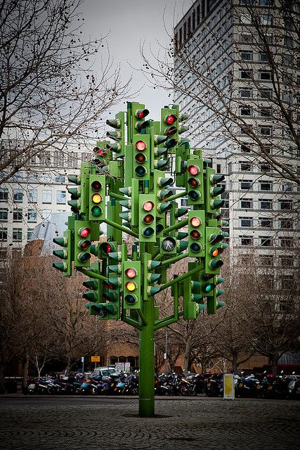 Traffic Light Tree;  roundabout near the Canary Wharf, London;  26 feet tall;  created by French artist Pierre Vivant;   installed in 1998, its 75 lights have an ever changing pattern, which is computer controlled;  photo by cyoung, via Flickr  - info from roamingthegooglestreets