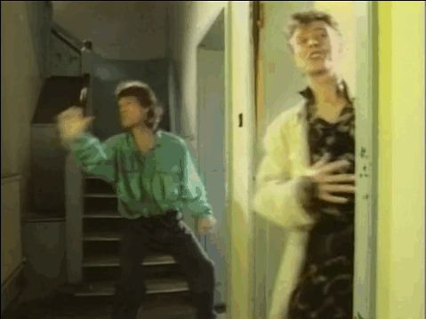 "Which was followed by David's awkward salsa dance moves: | The 9 Most Amazing Moments From David Bowie and Mick Jagger's ""Dancing In The Street"" Music Video"