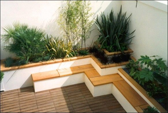 Japanese style roof terrace garden built in concrete planters wooden bench bamboo seating