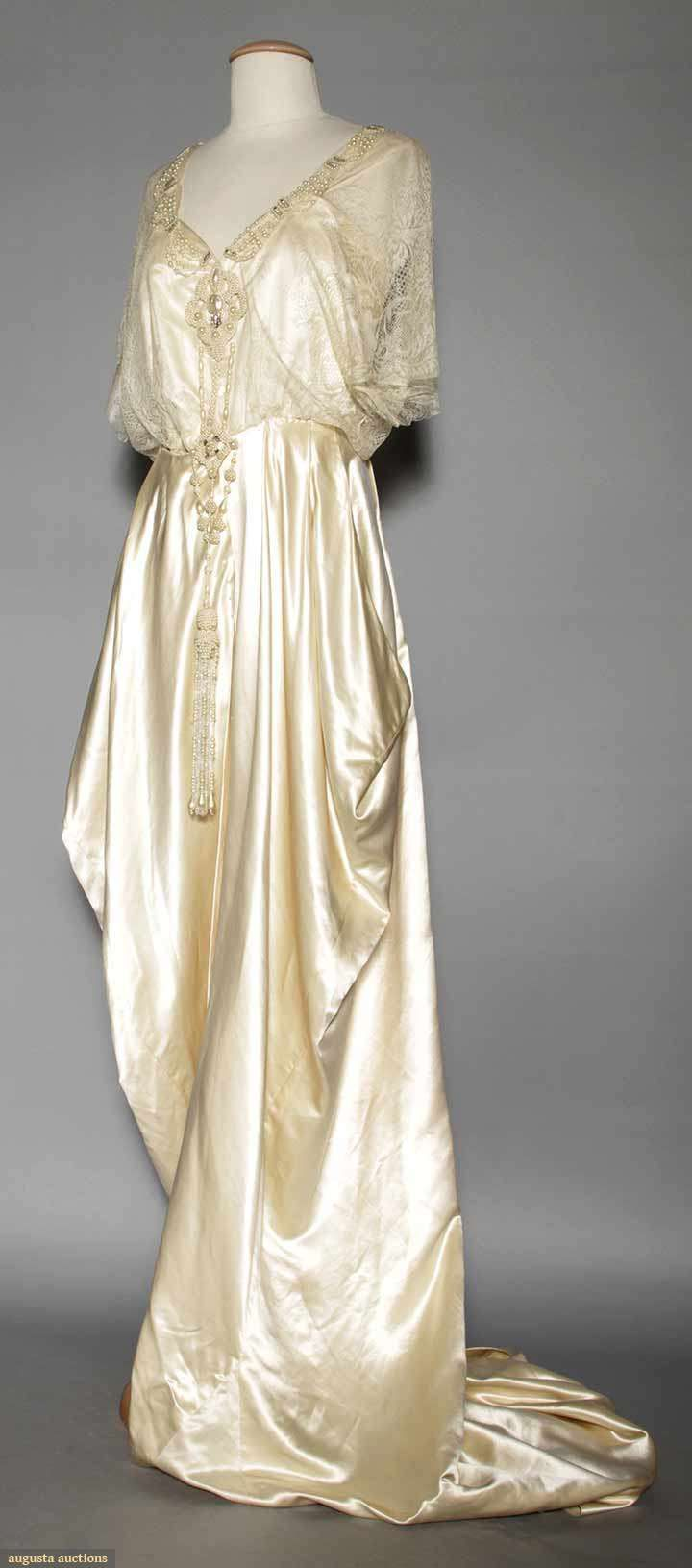 IVORY SILK SATIN WEDDING GOWN, 1912 Silk charmeuse trained gown, lace bodice trimmed w/ crystal beads & pearls.