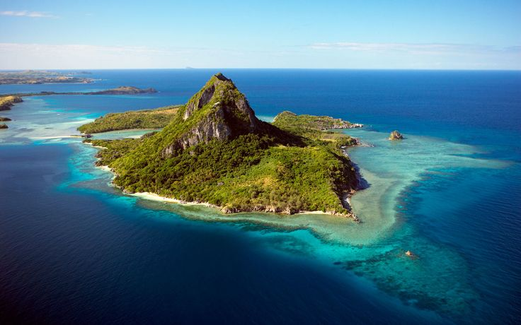Yasawa Island Resort & SpainFiji | Want to celebrate the holidays without freezing all winter long? These hotels and resorts in tropical, warm, and downright sunny destinations guarantee all the yuletide festivities you could dream of: without the snow.