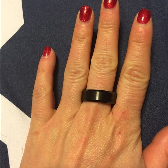 """Men's tungsten carbide wedding band Men's tungsten carbide """"Triton"""" black wedding band.... Worn once. Size 11 I think it was purchased at Beldon Jewelers Accessories Jewelry"""