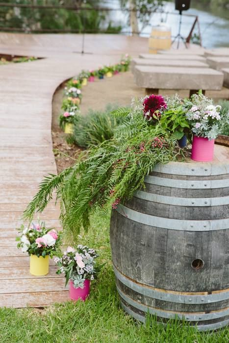 colourful tins full of beautiful flowers and textures created the theme for this weeding at Mitchelton Winery // Photography Ginger and Mint