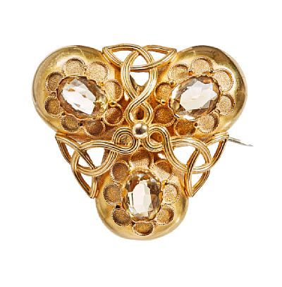 BROOCH - ART NOVEAU  Gold. 18 K.  Executive with three citrines. Total weight: 8.7 g. Ca 1900.  HEIGHT 3.5  WIDTH 4