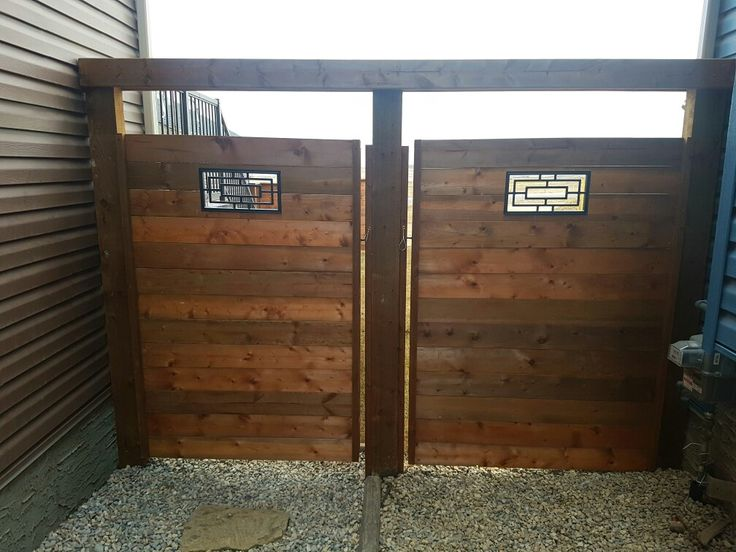 6ft gates horizontal Style with 2x6 arbour over head for strength and a rectangular insert.