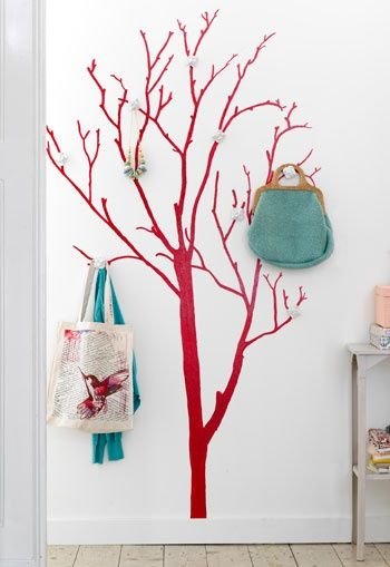 For your wall. (a place to hang totes, handbags, and more. would be cute with decorative items on the branches. -d.a.h.)