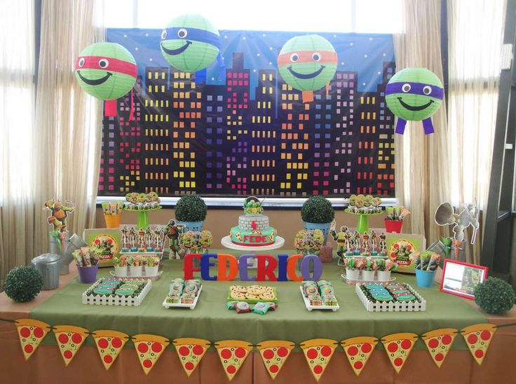 A fun Teenage Mutant Ninja Turtles birthday party. Just love the paper turtle heads hanging from the ceiling! See more party ideas at CatchMyParty.com