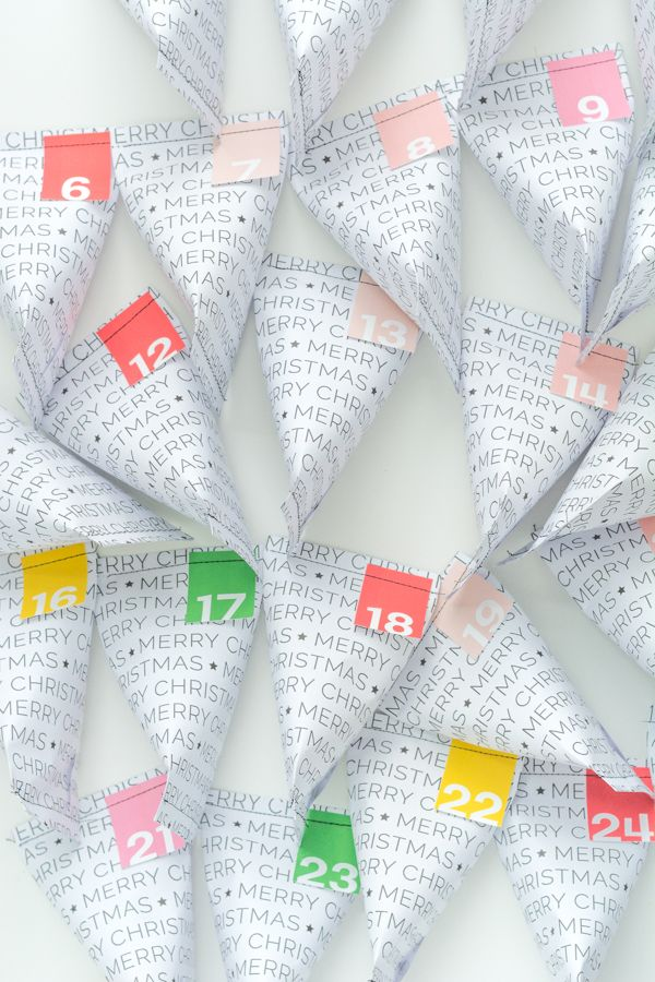 Easy DIY Advent Calendar - just print, trim, roll and staple. Free printable!
