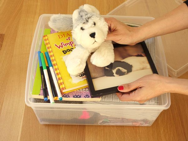 Moving box for each kid with essentials. // For cross country PCS, backpack for son with some sketching supplies, a new book, a fave book, book light, iPad mini, iPhone, any small toys he can travel with!  Excellent idea!!!