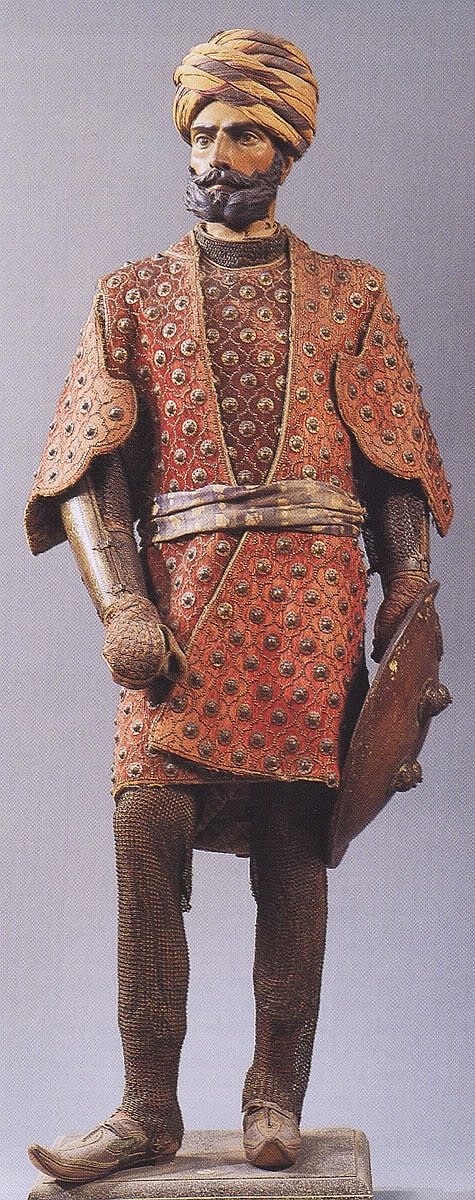 Chilta hazar masha (Coat of a thousand nails), bazu band (arm guards), zirah pajama (mail trousers), dhal (shield). Indian armored clothing made from layers of fabric faced with velvet and studded with numerous small brass nails, which were often gilded. Fabric armor was very popular in India because metal became very hot under the Indian sun. Stibbert Museum, Florence Italy.