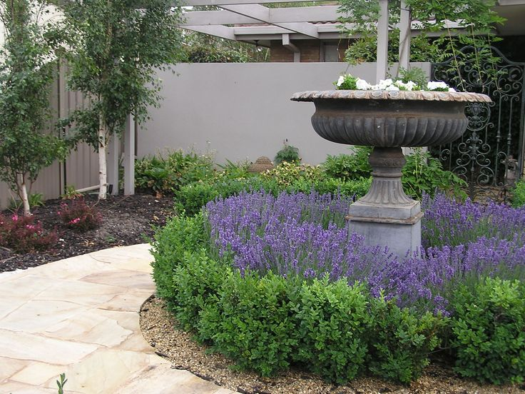 French country garden entrance with crazy pave sandstone path
