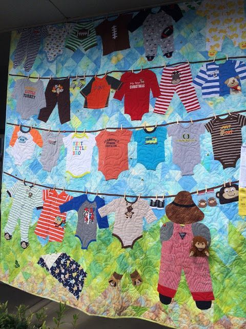 Quilt showcasing old baby clothes. Humble Quilts: Sisters Quilt Show