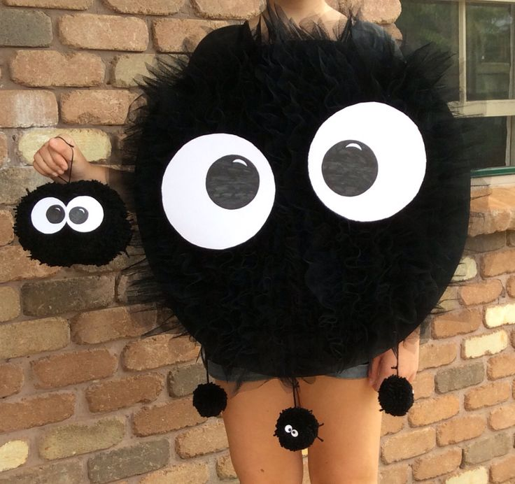 My children participated in a Cosplay event at our local library.  This is a Soot Sprite from Totoro.  Made by gathering and stitching tule to cardboard and adding some cute Pom poms.