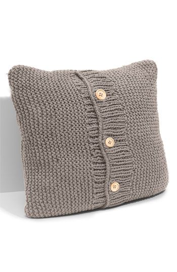 Who doesn't need a pillow dressed in a sweater?
