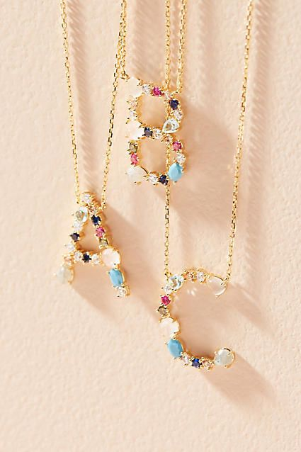 Choose your letter. Anthropologie Stone Encrusted Monogram Necklac. Glass stones, plated metal. Lobster clasp (Ad)