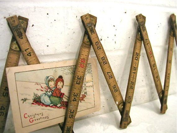 I love this idea of using an old carpenter's ruler as a card holder.
