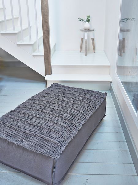 Relax and cosy up with one of our deeply comfy anthracite footstools, which have a knitted panel at the top for that on-trend home-spun feel.