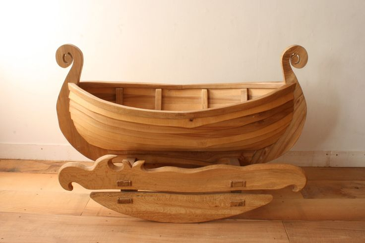 Kealwork Rocking Boat RKrb    This Rocking Viking Boat is an heirloom piece, it can be used as a cradle for a baby, then as a sit in rocking toy for older children, it is made from Sussex Elm, Ash, Oak and Laburnum.