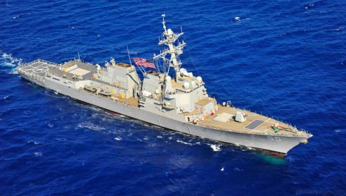 PACIFIC OCEAN (March 30 2014) The Arleigh Burke-class guided-missile destroyer USS Chafee (DDG 90) flies the U.S. Navy battle ensign while performing maneuvers off the coast of Hawaii. The ship was named for the late Senator John H. Chafee former Secretary of the Navy and decorated veteran of the Marine Corp. (U.S. Navy photo by Mass Communication Specialist 3rd Class Diana Quinlan/Released)