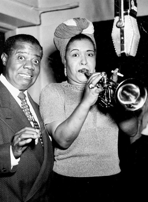 Billie Holiday and Louis Armstrong taking a break and fooling around during a Decca recording session, c. 1949