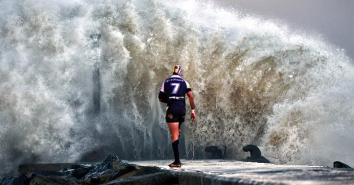 Cyclone Debbie Stands Still As Johnathan Thurston Slowly Walks Down The Strand