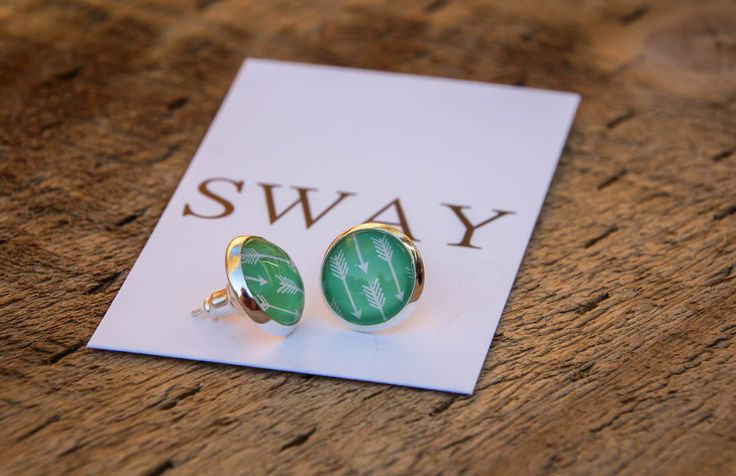 Silver tone stud style earring with Arrow print glass stone.