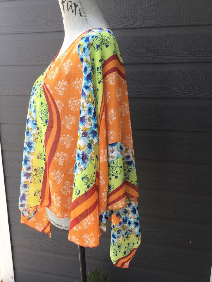 Such great vibrant colours in this poncho type lucy wrap.  Super cute over a tank top, camisole or a swimsuit!!   Wear it as a scarf, or tie the ends together for another great look!!!  One size fits lots of fabulous women