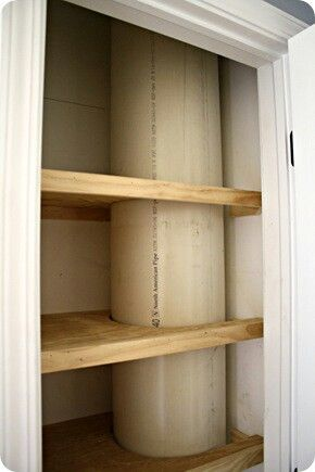 Laundry chute with a large PVC pipe. This one was installed under a bathroom vanity and down thru a linen closet. Smooth inside and water resistant...brilliant