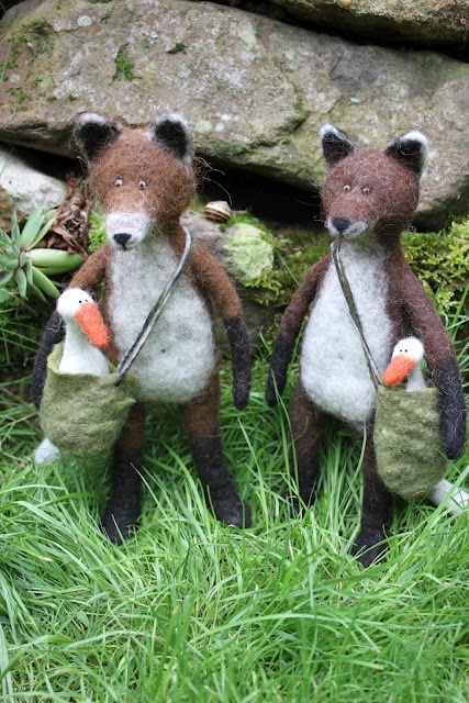 By: Filzkram.  These are so cute a well made.  I think the arms and legs might be a little wet felted, the little pouches are for the geese.  I love that she didn't use glass eyes, she did that with a needle.  Love all her details.
