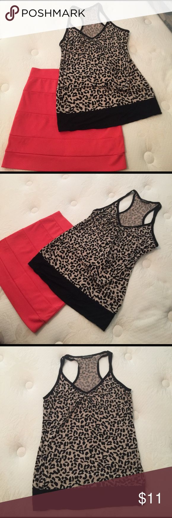 Body Central Outfit leopard top/ coral skirt sz:M Body Central Outfit leopard top/ coral skirt sz: M. The skirt is a tight and coral. The top is racerback loose leopard and black. Make an offer ❤ Body Central Skirts Mini