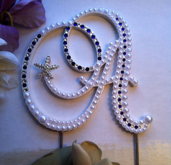 This listing is for a beautiful Pearl Wedding Monogram Cake Topper embellished with flat back pearls, blue and clear Swarovski Crystals and a rhinestone brooch, the brooch can be changed out, I have a wide array of brooches to choose from, including some vintage pieces (which will