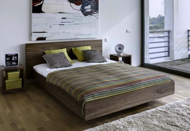 DIY Platform Bed - Floating. I love the few inches of space at the bottom. Wouldn't an antique door or shutters make a cool headboard?