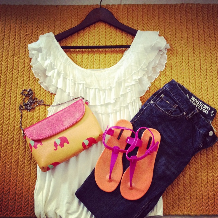 Pair your GoBahamas jelly sandals with a basic tee and your favorite denims for a color-tastic look.
