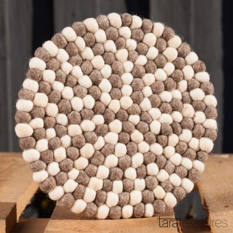 Pebbles Pot Trivet. Beautiful and functional, this felt pot trivet in neutral pebble colours is made to withstand heat without damaging your tabletop. We have always used this pot trivet as a pretty placemat when transfering the cast iron pot from the cooktop to the tabletop. #feltpottrivet
