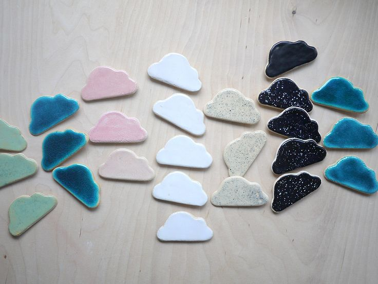 cloud magnets for kids in simple colours: white, pink, black with white dots, transparent with black dots, minty and light blue