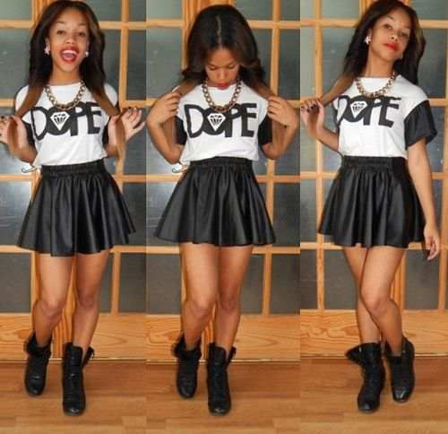 dope shirt leather skirt black boots not digging the shirt but the outfit is cute.