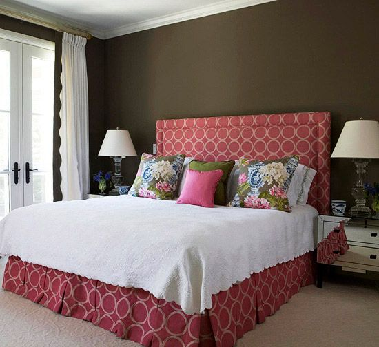 Love how the headboard and the bed skirt are upholstered in the same rosy geometric fabric.