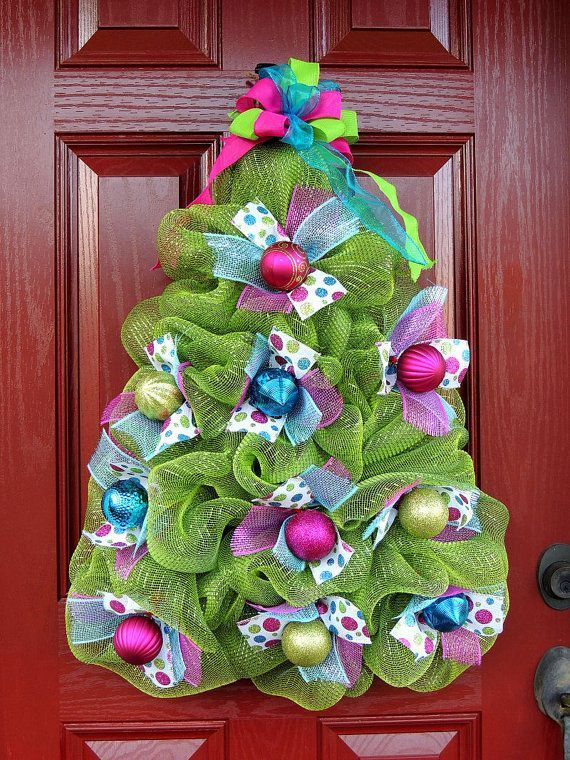 Beautiful and huge wreath will look amazing for your front door to hang on the wall, interior door or above your mantel. Deco mesh Christmas tree wreath. Included in this wreath is Moss Lime green deco mesh, premium metallic Turquoise Blue and Pink mesh, 4 types of high quality ribbons, ornaments and glittery balls (if available). Please note: ornaments might not look exact the same as shown depends what I have in stock so sometimes glitter balls are not available. This wreath can be made in…